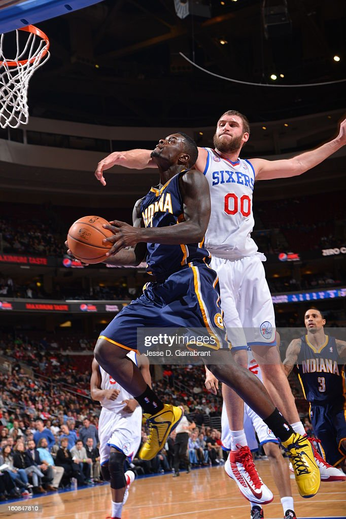 Lance Stephenson #1 of the Indiana Pacers goes to the basket against Spencer Hawes #00 of the Philadelphia 76ers during the game at the Wells Fargo Center on February 6, 2013 in Philadelphia, Pennsylvania.
