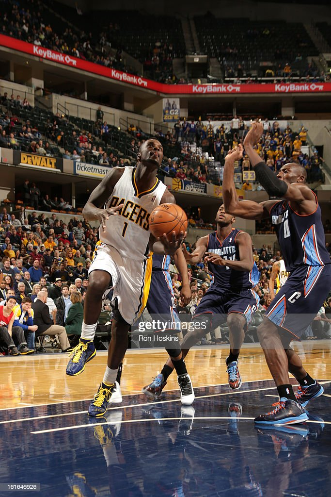 Lance Stephenson #1 of the Indiana Pacers goes to the basket against Bismack Biyombo #0 of the Charlotte Bobcats on February 13, 2013 at Bankers Life Fieldhouse in Indianapolis, Indiana.