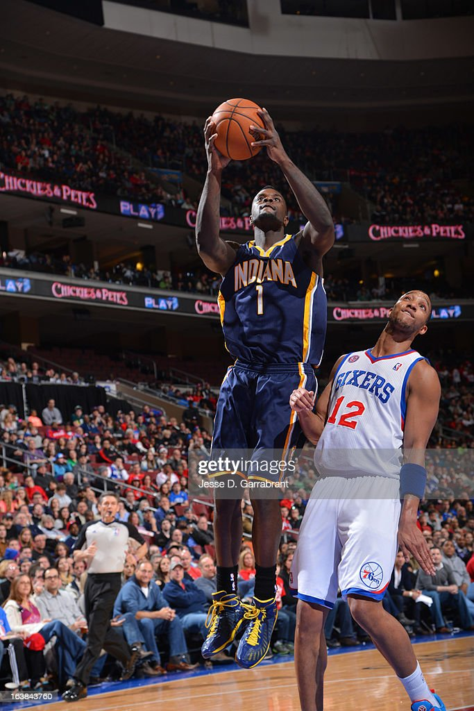 Lance Stephenson #1 of the Indiana Pacers goes to the basket against Evan Turner #12 of the Philadelphia 76ers at the Wells Fargo Center on March 16, 2013 in Philadelphia, Pennsylvania.