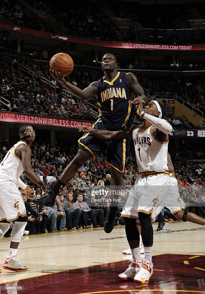 <a gi-track='captionPersonalityLinkClicked' href=/galleries/search?phrase=Lance+Stephenson&family=editorial&specificpeople=5298304 ng-click='$event.stopPropagation()'>Lance Stephenson</a> #1 of the Indiana Pacers goes up for the shot against <a gi-track='captionPersonalityLinkClicked' href=/galleries/search?phrase=Daniel+Gibson&family=editorial&specificpeople=213906 ng-click='$event.stopPropagation()'>Daniel Gibson</a> #1 of the Cleveland Cavaliers at The Quicken Loans Arena on December 21, 2012 in Cleveland, Ohio.