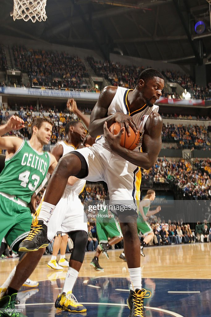 Lance Stephenson #1 of the Indiana Pacers grabs the rebound against the Boston Celtics at Bankers Life Fieldhouse on December 22, 2013 in Indianapolis, Indiana.