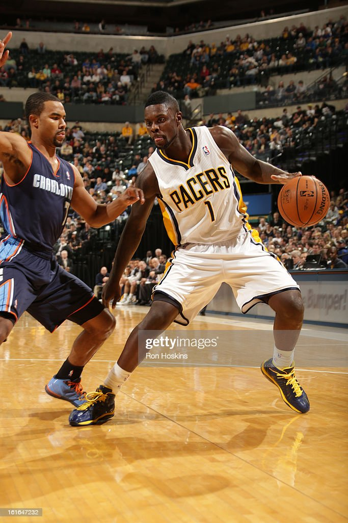 <a gi-track='captionPersonalityLinkClicked' href=/galleries/search?phrase=Lance+Stephenson&family=editorial&specificpeople=5298304 ng-click='$event.stopPropagation()'>Lance Stephenson</a> #1 of the Indiana Pacers handles the ball against <a gi-track='captionPersonalityLinkClicked' href=/galleries/search?phrase=Ramon+Sessions&family=editorial&specificpeople=805440 ng-click='$event.stopPropagation()'>Ramon Sessions</a> #7 of the Charlotte Bobcats on February 13, 2013 at Bankers Life Fieldhouse in Indianapolis, Indiana.