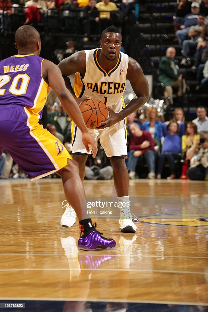 Lance Stephenson #1 of the Indiana Pacers looks to pass the ball against Jodie Meeks #20 of the Los Angeles Lakers on March 15, 2013 at Bankers Life Fieldhouse in Indianapolis, Indiana.