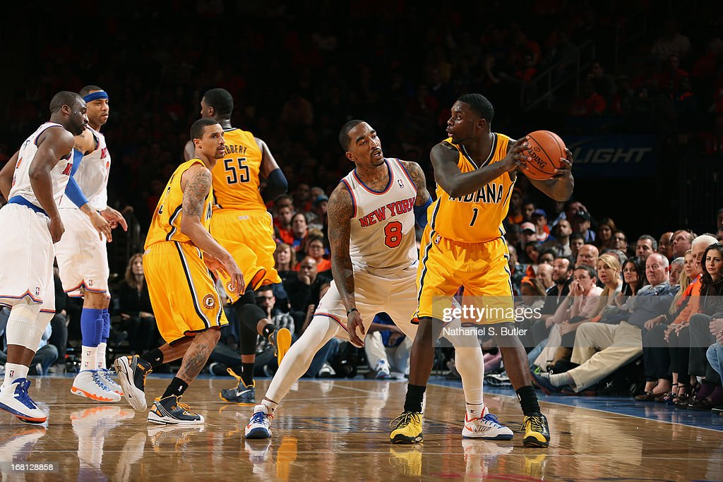 <a gi-track='captionPersonalityLinkClicked' href=/galleries/search?phrase=Lance+Stephenson&family=editorial&specificpeople=5298304 ng-click='$event.stopPropagation()'>Lance Stephenson</a> #1 of the Indiana Pacers looks to pass the ball against <a gi-track='captionPersonalityLinkClicked' href=/galleries/search?phrase=J.R.+Smith&family=editorial&specificpeople=201766 ng-click='$event.stopPropagation()'>J.R. Smith</a> #8 of the New York Knicks in Game One of the Eastern Conference Semifinals during the 2013 NBA Playoffs on May 5, 2013 at Madison Square Garden in New York City.