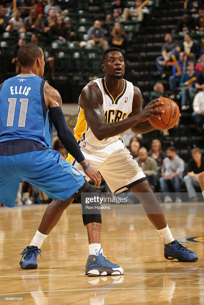 <a gi-track='captionPersonalityLinkClicked' href=/galleries/search?phrase=Lance+Stephenson&family=editorial&specificpeople=5298304 ng-click='$event.stopPropagation()'>Lance Stephenson</a> #1 of the Indiana Pacers looks to pass the ball against <a gi-track='captionPersonalityLinkClicked' href=/galleries/search?phrase=Monta+Ellis&family=editorial&specificpeople=567403 ng-click='$event.stopPropagation()'>Monta Ellis</a> #11 of the Dallas Mavericks at Bankers Life Fieldhouse on October 16, 2013 in Indianapolis, Indiana.
