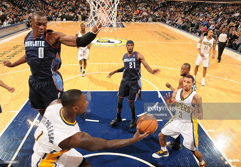 Lance Stephenson #1 of the Indiana Pacers makes a pass to George Hill #3 of the Indiana Pacers during the game between the Indiana Pacers and the Charlotte Bobcats on January 12, 2013 at Bankers Life Fieldhouse in Indianapolis, Indiana.