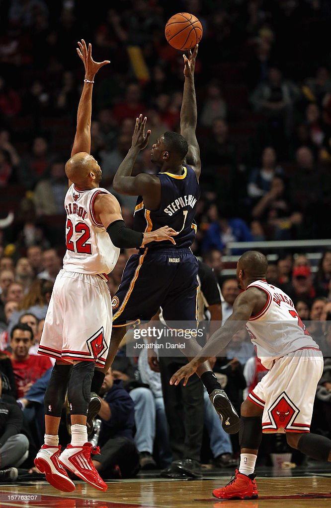 Lance Stephenson #1 of the Indiana Pacers puts up a shot between Taj Gibson #22 and Nate Robinson #2 of the Chicago Bulls at the United Center in Chicago, Illinois. The Pacers defeated the Bulls 80-76.