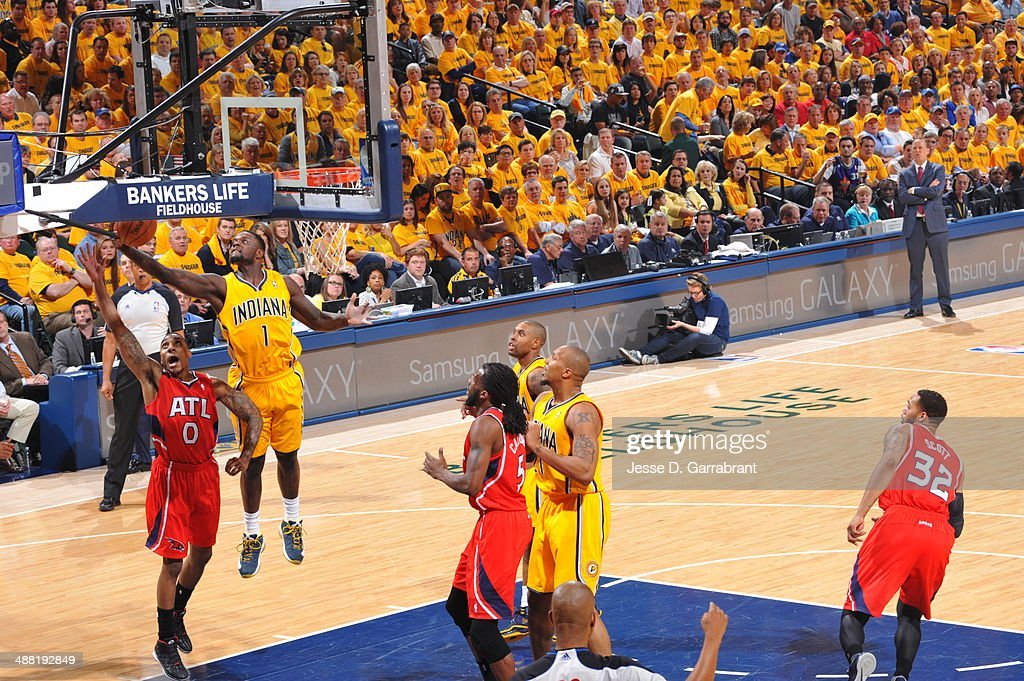 Lance Stephenson #1 of the Indiana Pacers rebounds the ball against Jeff Teague #0 of the Atlanta Hawks during Game Seven of the Eastern Conference Quarterfinals during the 2014 NBA Playoffs on May 3, 2014 at Bankers Life Fieldhouse in Indianapolis, Indiana.