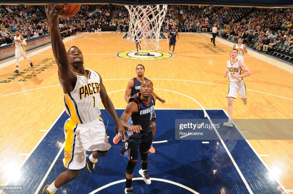 Lance Stephenson #1 of the Indiana Pacers shoots a layup against Kemba Walker #15 of the Charlotte Bobcats on February 13, 2013 at Bankers Life Fieldhouse in Indianapolis, Indiana.