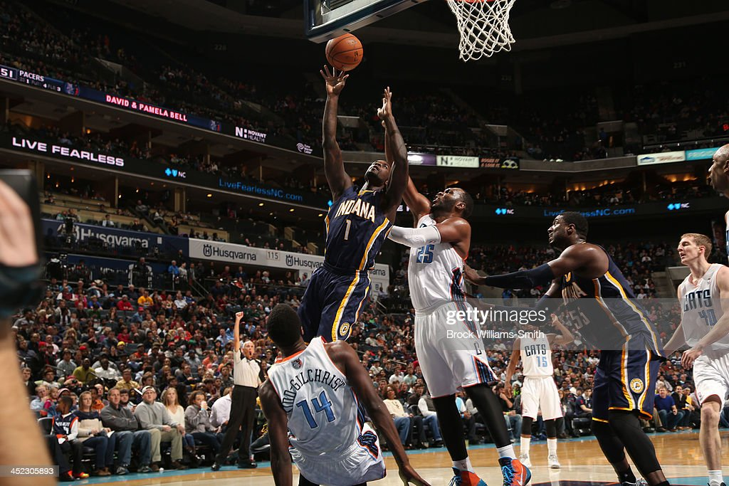 <a gi-track='captionPersonalityLinkClicked' href=/galleries/search?phrase=Lance+Stephenson&family=editorial&specificpeople=5298304 ng-click='$event.stopPropagation()'>Lance Stephenson</a> #1 of the Indiana Pacers shoots against <a gi-track='captionPersonalityLinkClicked' href=/galleries/search?phrase=Al+Jefferson&family=editorial&specificpeople=201604 ng-click='$event.stopPropagation()'>Al Jefferson</a> #25 of the Charlotte Bobcats during the game at the Time Warner Cable Arena on November 27, 2013 in Charlotte, North Carolina.