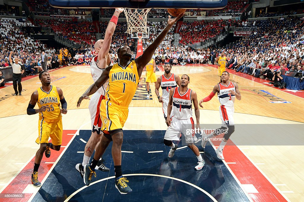 <a gi-track='captionPersonalityLinkClicked' href=/galleries/search?phrase=Lance+Stephenson&family=editorial&specificpeople=5298304 ng-click='$event.stopPropagation()'>Lance Stephenson</a> #1 of the Indiana Pacers shoots against <a gi-track='captionPersonalityLinkClicked' href=/galleries/search?phrase=Marcin+Gortat&family=editorial&specificpeople=589986 ng-click='$event.stopPropagation()'>Marcin Gortat</a> #4 of the Washington Wizards in Game Six of the Eastern Conference Semifinals on May 15, 2014 at the Verizon Center in Washington, D.C.