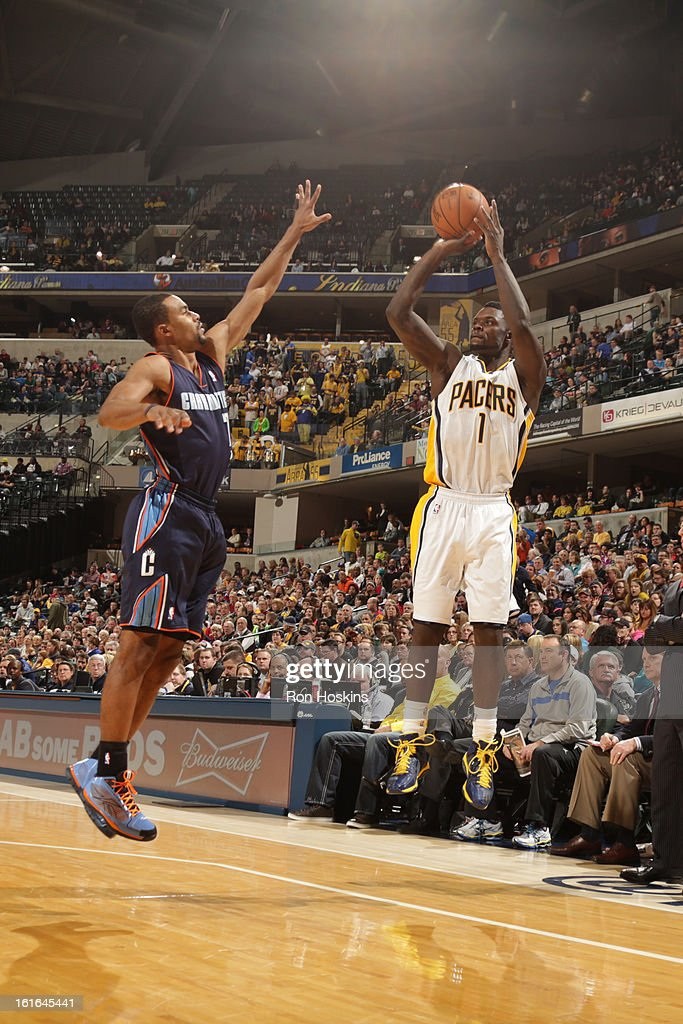 Lance Stephenson #1 of the Indiana Pacers shoots against Ramon Sessions #7 of the Charlotte Bobcats on February 13, 2013 at Bankers Life Fieldhouse in Indianapolis, Indiana.