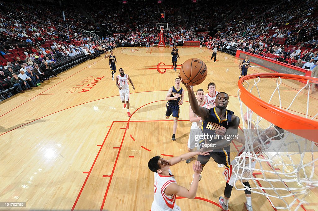<a gi-track='captionPersonalityLinkClicked' href=/galleries/search?phrase=Lance+Stephenson&family=editorial&specificpeople=5298304 ng-click='$event.stopPropagation()'>Lance Stephenson</a> #1 of the Indiana Pacers shoots the ball against <a gi-track='captionPersonalityLinkClicked' href=/galleries/search?phrase=Jeremy+Lin&family=editorial&specificpeople=6669516 ng-click='$event.stopPropagation()'>Jeremy Lin</a> #7 of the Houston Rockets on March 27, 2013 at the Toyota Center in Houston, Texas.