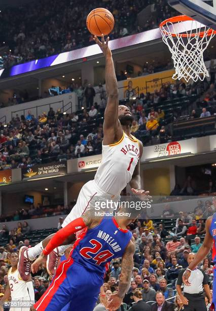 Lance Stephenson of the Indiana Pacers shoots the ball over Eric Moreland of the Detroit Pistons at Bankers Life Fieldhouse on November 17 2017 in...