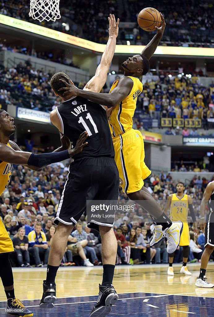 <a gi-track='captionPersonalityLinkClicked' href=/galleries/search?phrase=Lance+Stephenson&family=editorial&specificpeople=5298304 ng-click='$event.stopPropagation()'>Lance Stephenson</a> #1 of the Indiana Pacers shoots the ball while defended by <a gi-track='captionPersonalityLinkClicked' href=/galleries/search?phrase=Brook+Lopez&family=editorial&specificpeople=3847328 ng-click='$event.stopPropagation()'>Brook Lopez</a> # 11 of the Brooklyn Nets at Bankers Life Fieldhouse on April 12, 2013 in Indianapolis, Indiana.