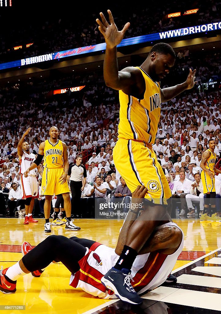 Lance Stephenson of the Indiana Pacers stands over LeBron James of the Miami Heat during Game Six of the Eastern Conference Finals of the 2014 NBA...