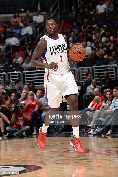 Lance Stephenson of the Los Angeles Clippers brings the ball up court against the Denver Nuggets during a preseason game on October 2 2015 at STAPLES...