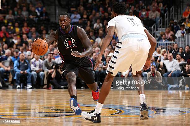 Lance Stephenson of the Los Angeles Clippers controls the ball against Will Barton of the Denver Nuggets at Pepsi Center on November 24 2015 in...