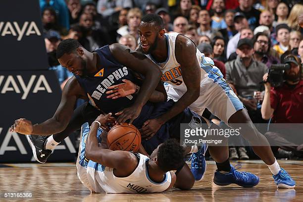 Lance Stephenson of the Memphis Grizzlies contests Emmanuel Mudiay and JaKarr Sampson of the Denver Nuggets for a loose ball at Pepsi Center on...