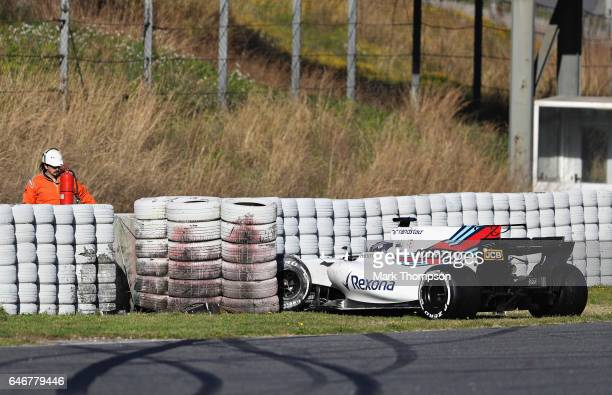 Lance Stroll of Canada driving the Williams Martini Racing Williams FW40 Mercedes crashes into a barrier on track during day three of Formula One...