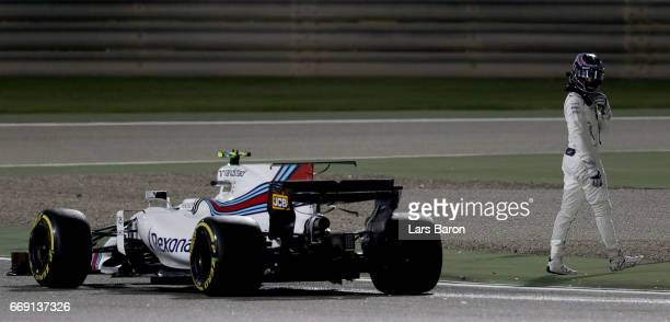 Lance Stroll of Canada driving the Williams Martini Racing Williams FW40 Mercedes stops on circuit during the Bahrain Formula One Grand Prix at...