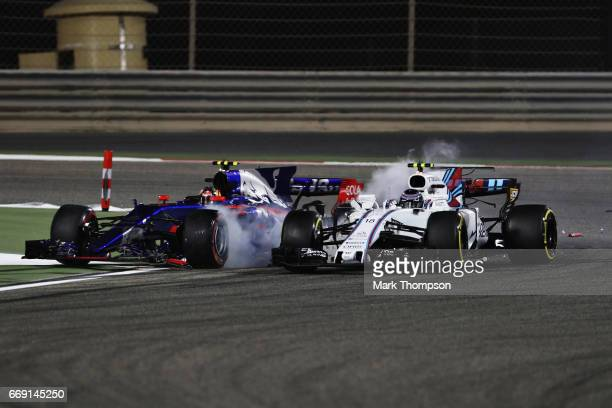 Lance Stroll of Canada driving the Williams Martini Racing Williams FW40 Mercedes collides with Carlos Sainz of Spain driving the Scuderia Toro Rosso...