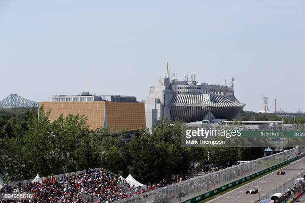 Lance Stroll of Canada driving the Williams Martini Racing Williams FW40 Mercedes leads Fernando Alonso of Spain driving the McLaren Honda Formula 1...