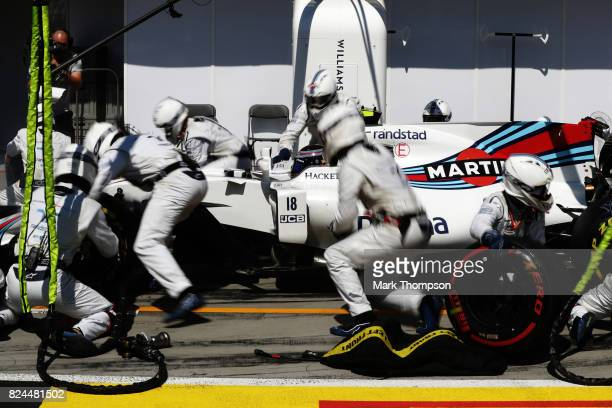 Lance Stroll of Canada driving the Williams Martini Racing Williams FW40 Mercedes makes a pit stop for new tyres during the Formula One Grand Prix of...