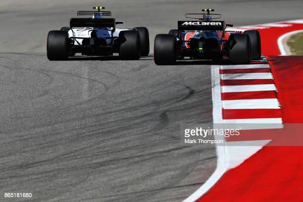 Lance Stroll of Canada driving the Williams Martini Racing Williams FW40 Mercedes and Stoffel Vandoorne of Belgium driving the McLaren Honda Formula...