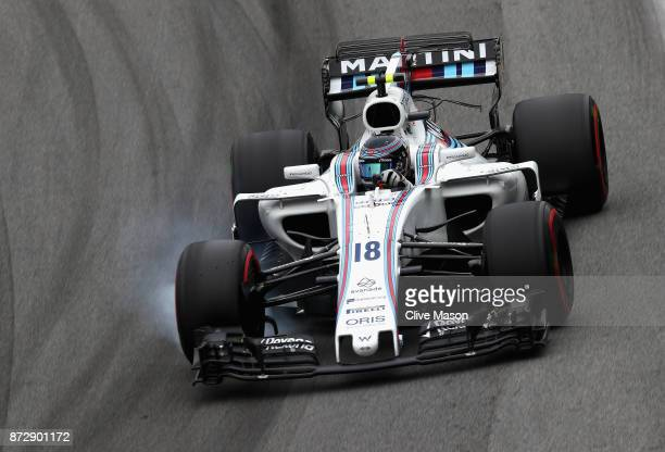 Lance Stroll of Canada driving the Williams Martini Racing Williams FW40 Mercedes locks a wheel under braking during qualifying for the Formula One...