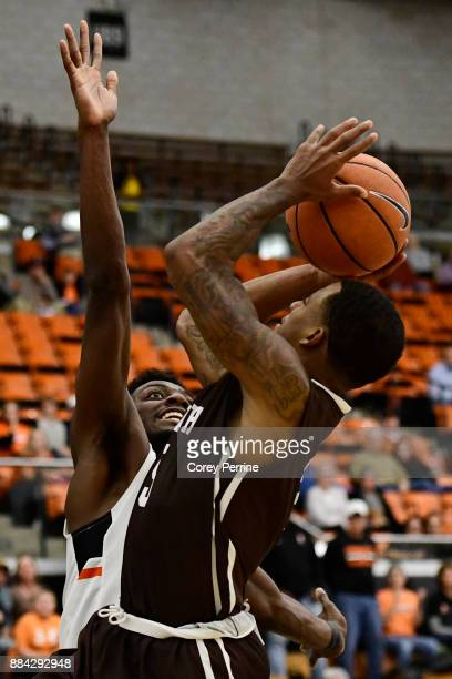 Lance Tejada of the Lehigh Mountain Hawks drives to the basket against Myles Stephens of the Princeton Tigers during the second half at L Stockwell...