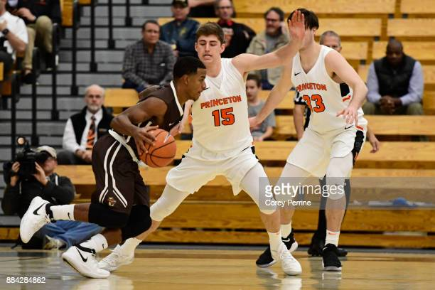Lance Tejada of the Lehigh Mountain Hawks drives to the basket against Ryan Schwieger of the Princeton Tigers during the first half at L Stockwell...