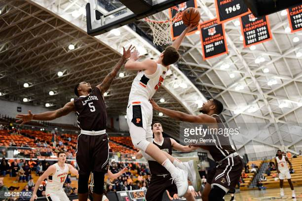 Lance Tejada Pat Andree and Kyle Leufroy of the Lehigh Mountain Hawks look to defend against Ryan Schwieger of the Princeton Tigers during the first...
