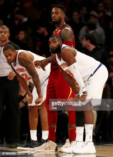 Lance Thomas and Tim Hardaway Jr #3 of the New York Knicks react as Jeff Green of the Cleveland Cavaliers stands by in the fourth quarter at Madison...
