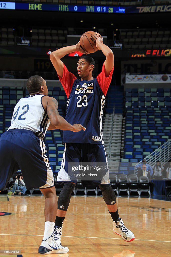 Lance Thomas #42 (l) defends Anthony Davis #23 of the New Orleans Pelicans during an open scrimmage on October 25, 2013 at the New Orleans Arena in New Orleans, Louisiana.