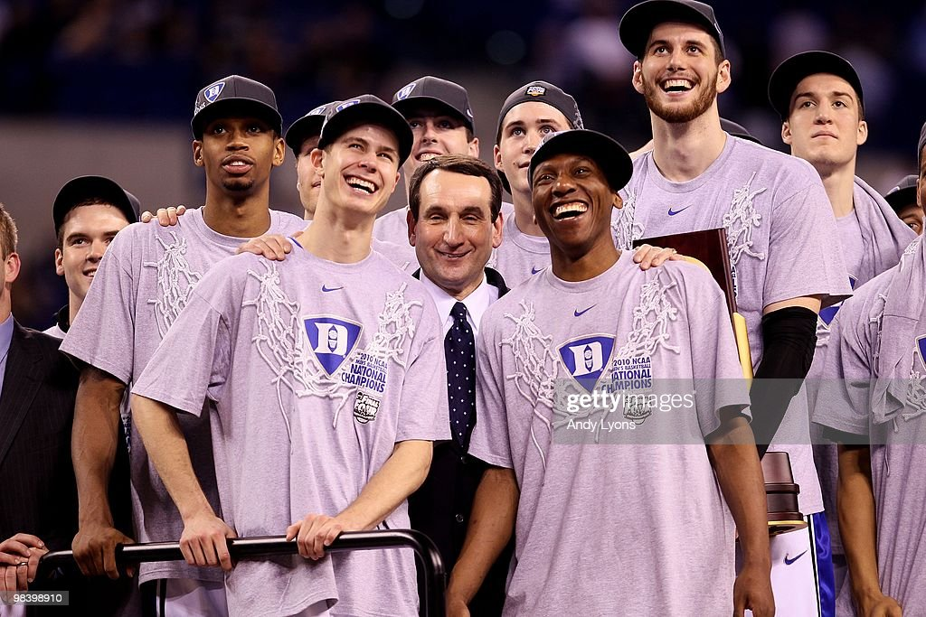 Lance Thomas #42 <a gi-track='captionPersonalityLinkClicked' href=/galleries/search?phrase=Jon+Scheyer&family=editorial&specificpeople=3847405 ng-click='$event.stopPropagation()'>Jon Scheyer</a> #30, head coach Mike Krzyzewski, Nolan Smith #2 and <a gi-track='captionPersonalityLinkClicked' href=/galleries/search?phrase=Brian+Zoubek&family=editorial&specificpeople=4091585 ng-click='$event.stopPropagation()'>Brian Zoubek</a> #55 of the Duke Blue Devils watch CBS 's presentation of 'One Shining Moment' as they celebrate after they won 61-59 against the Butler Bulldogs during the 2010 NCAA Division I Men's Basketball National Championship game at Lucas Oil Stadium on April 5, 2010 in Indianapolis, Indiana.