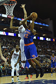 Lance Thomas of New York Knicks under pressure from John Henson of Milwaukee Bucks during the 2015 NBA Global Games London match between Milwaukee...
