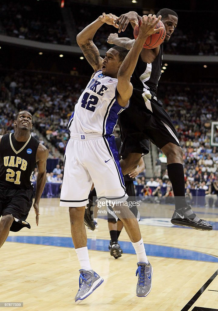 Lance Thomas of the Duke Blue Devils is defended by Hugh Barnett of the ArkansasPine Bluff Golden Lions during the first round of the 2010 NCAA men's...