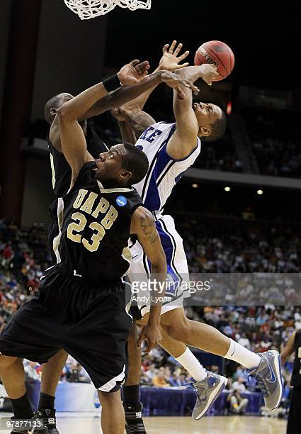 Lance Thomas of the Duke Blue Devils is defended by Savalace Townsend and Hugh Barnett of the ArkansasPine Bluff Golden Lions during the first round...