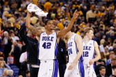 Lance Thomas of the Duke Blue Devils reacts in the second half from the bench while taking on the West Virginia Mountaineers during the National...