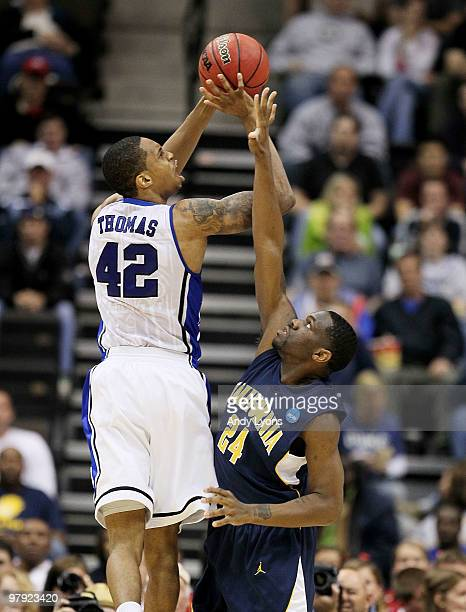 Lance Thomas of the Duke Blue Devils shoots over Theo Robertson of the California Golden Bears during the second round of the 2010 NCAA men's...