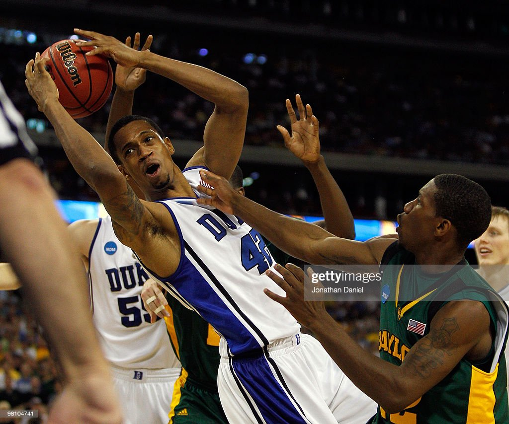 Lance Thomas of the Duke Dlue Devils pulls down a rebound in front of AJ Walton of the Baylor Bears during the south regional final of the 2010 NCAA...