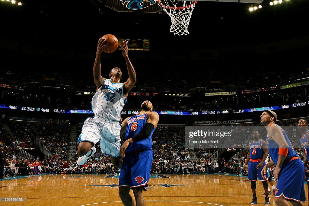 Lance Thomas #42 of the New Orleans Hornets drives to the basket against Tyson Chandler #6 of the New York Knicks on November 20, 2012 at the New Orleans Arena in New Orleans, Louisiana.