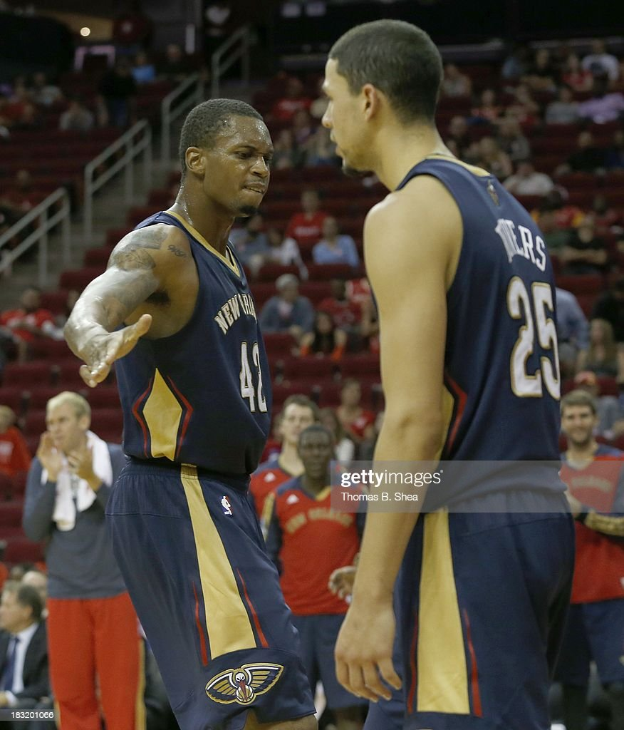 Lance Thomas #42 of the New Orleans Pelicans celebrates a basket by Austin Rivers #25 of the New Orleans Pelicans against the Houston Rockets in a preseason NBA game on October 5, 2013 at Toyota Center in Houston, Texas. The Pelicans won 116-115.