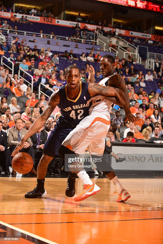 <a gi-track='captionPersonalityLinkClicked' href=/galleries/search?phrase=Lance+Thomas&family=editorial&specificpeople=3847256 ng-click='$event.stopPropagation()'>Lance Thomas</a> #42 of the New Orleans Pelicans drives against <a gi-track='captionPersonalityLinkClicked' href=/galleries/search?phrase=Archie+Goodwin&family=editorial&specificpeople=9086088 ng-click='$event.stopPropagation()'>Archie Goodwin</a> #20 of the Phoenix Suns on November 10, 2013 at U.S. Airways Center in Phoenix, Arizona.