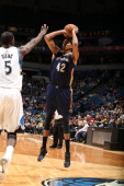 Lance Thomas of the New Orleans Pelicans shoots the ball against the Minnesota Timberwolves during the game on January 1 2014 at Target Center in...