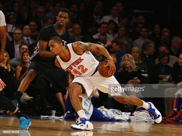 Lance Thomas of the New York Knicks drives against Andrew Wiggins of the Minnesota Timberwolves during their game at Madison Square Garden on March...