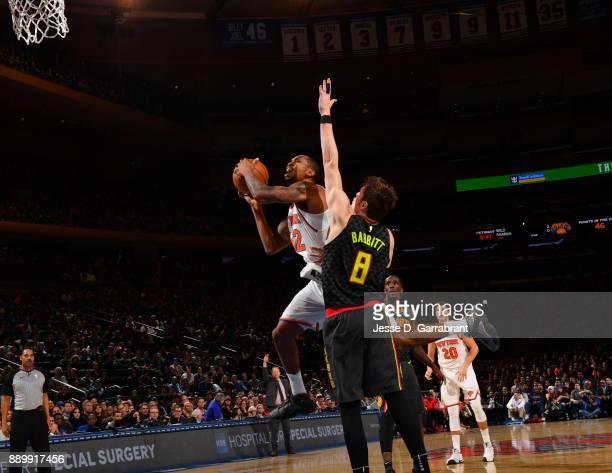 Lance Thomas of the New York Knicks drives to the basket against the Atlanta Hawks at Madison Square Garden on December 10 2017 in New York New York...