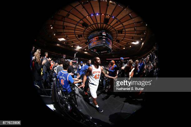 Lance Thomas of the New York Knicks exchanges high fives with fans after the game against the Toronto Raptors on November 22 2017 at Madison Square...