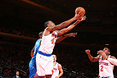 Lance Thomas of the New York Knicks grabs the rebound against the Oklahoma City Thunder during the game on January 28 2015 at Madison Square Garden...